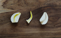 Garlic. On chopping wooden board.  sprout taken out from  clove. Indoor photography royalty free stock photos