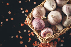 Garlic Close Up with Pink Himalayan Salt Stock Photo