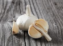 Garlic and clove close-up. Garlic and clove on wood royalty free stock photos