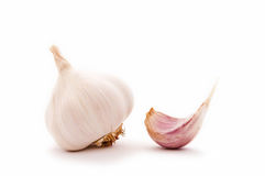 Garlic clove and garlic bulb. Garlic bulb and garlic clove stock photos