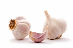 Garlic clove and garlic bulbs Royalty Free Stock Image