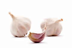 Garlic clove and garlic bulbs Royalty Free Stock Photo