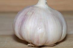 Garlic clove. On wooden background stock photos