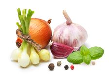 Garlic clove, onion,red pepper and spices. Garlic clove, onion and spices on wooden background stock photography