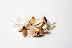 Garlic cloves close up isolated. Garlic is used for many conditions related to the heart and blood system. These conditions include high blood pressure, high royalty free stock photo