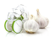 Garlic Cloves with cutter on white Royalty Free Stock Image