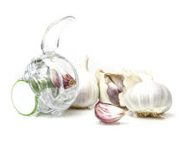 Garlic Cloves with cutter on white Royalty Free Stock Photography