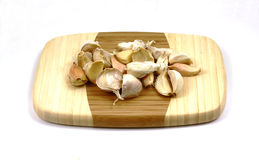 Garlic cloves cutting board Stock Photo