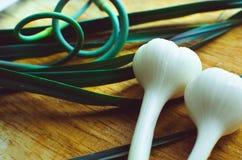Garlic cloves on a cutting board Stock Image