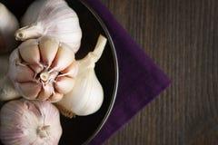 Garlic and garlic cloves on dark royalty free stock photo