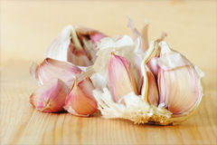 Garlic. Cloves of freshly peeled garlic on a kitchen board Stock Images