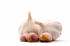 Garlic cloves and garlic bulbs Royalty Free Stock Images