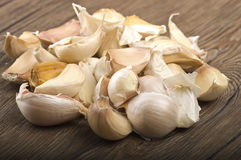 Garlic cloves. Group of garlic cloves on the wood Stock Photography