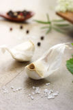 Garlic cloves with herbs Stock Photo