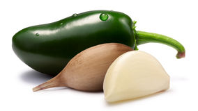 Garlic cloves with Jalapeno - hot sauce ingredients, paths Royalty Free Stock Photography