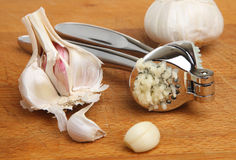 Garlic Cloves with Press or Crusher Stock Photo