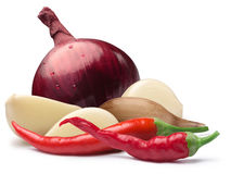 Garlic cloves, red onion, cayenne, paths Stock Image