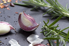 Garlic cloves with rosemary Stock Images