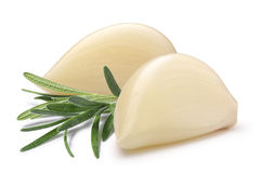 Garlic cloves with rosemary, paths. Husked and split garlic cloves with rosemary. Clipping paths, shadow separated. Design elements Royalty Free Stock Images