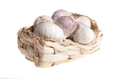 Garlic cloves in wicker basket Stock Photos
