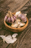 Garlic cloves in wooden bowl Royalty Free Stock Image