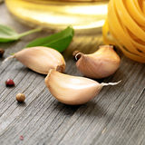 Garlic cloves on wooden table close up Stock Photo