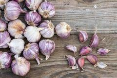 Garlic cloves on wooden vintage background. stock images