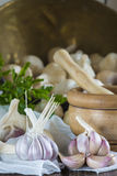 Garlic for cooking on the table of the kitchen Royalty Free Stock Photo
