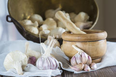 Garlic for cooking on the table of the kitchen Royalty Free Stock Image