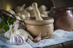 Garlic for cooking on the table of the kitchen Stock Images