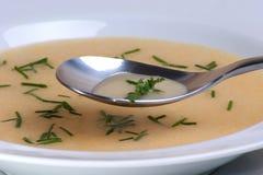 Garlic cream soup in a white bowl Royalty Free Stock Photos