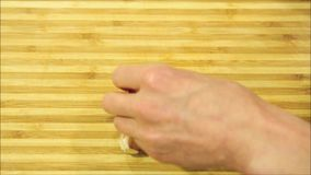 Garlic crushed and peeled video stock footage
