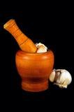 Garlic crusher. Image of traditional garlic crusher isolated on black background Royalty Free Stock Image
