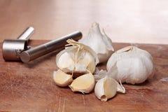 Garlic and crusher Royalty Free Stock Image