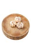 Garlic on the cut board. Garlic on the chopping board Stock Photography
