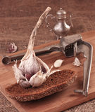 Garlic on Cutting Board Stock Photo