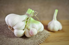 Garlic. Detail of garlic vegetable on old wooden board royalty free stock photography