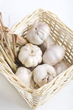 Garlic and dried lemon grass inside a basket Stock Photo