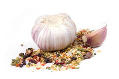 Garlic with dried vegetables and spices. Isolated on white Stock Images