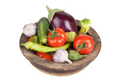 Garlic, eggplants, tomatoes, onion, cucumbers and peppers in old Royalty Free Stock Photo