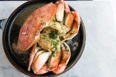 Garlic flavor crab. Garlic flavor Dungeness crab served on cook pan Stock Image