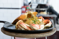 Garlic flavor crab. Garlic flavor Dungeness crab served on cook pan Royalty Free Stock Photography