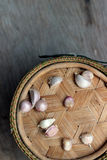 Garlic. Fresh garlic on bamboo container Royalty Free Stock Photography