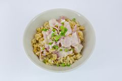 Garlic fried rice with ham sliced and vegetable on top Royalty Free Stock Photography