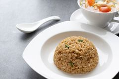 Garlic fried rice and hot soup chicken healthy at morning on concrete table stock photography