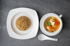 Garlic fried rice and hot soup chicken healthy at morning on concrete table stock photo