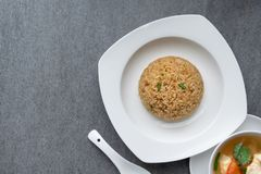 Garlic fried rice and hot soup chicken healthy at morning on concrete table royalty free stock photography
