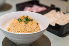 Garlic fried rice with vegetables on top Royalty Free Stock Images
