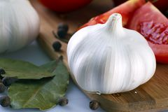 Garlic Fruit. With Some Other Vegetables and Spices in Background stock photography