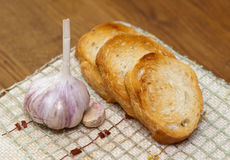 Garlic and garlic bread Royalty Free Stock Image